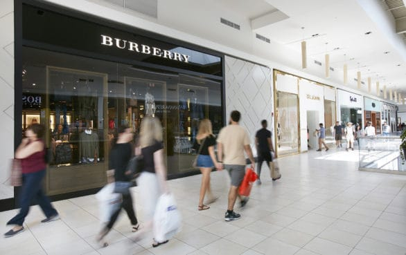 Shoppers in front of the Burberry store at Fashion Outlets of Chicago