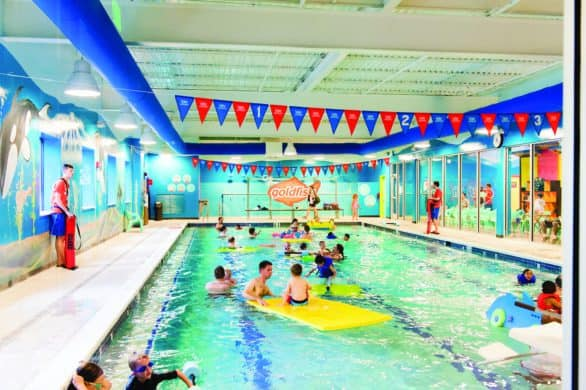 Families playing at Goldfish Swim School during a Family Swim