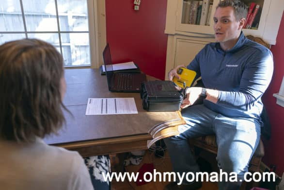 Radon Gas Measurement Specialist from Thrasher reviewing results from the Continuous Radon Monitor