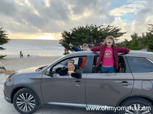 Family in the car at Carmel Beach in California