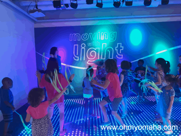 Dancing in the Moving With Light exhibit at Omaha Children's Museum