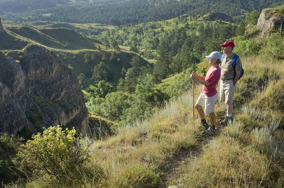 Hikers on a trail overlooking Chadron State Park in western Nebraska