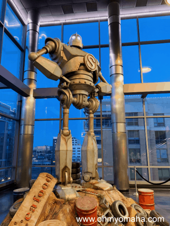 Things to do at Midtown Crossing with kids - Find the huge Iron Giant inside Alamo Drafthouse
