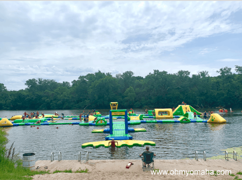 Water fun in Nebraska - One of the popular summer activities to do is play on the inflatable floating obstacle course at Louisville State Recreation Area.