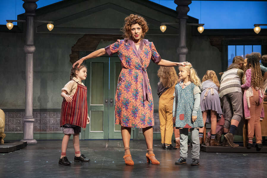 "Allison Wissman, center, is Miss Hannigan in the Omaha Community Playhouse production of ""Annie."""