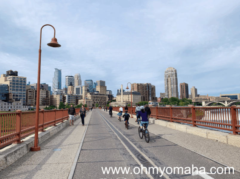 Things to do with kids in Minneapolis - Bike alone the Stone Arch Bridge,  pedestrian bridge in downtown Minneapolis