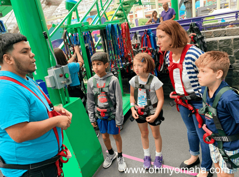 Listening to safety tips at Dutchman's Deck Adventure Course at Nickelodeon Universe.