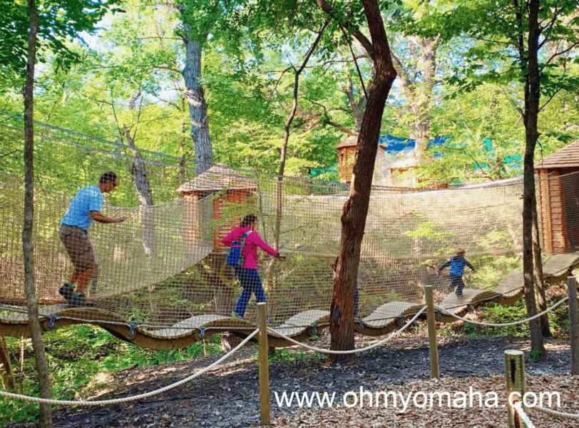 Things to do with kids in Nebraska City - Visit Treetop Village at Arbor Day Farm Tree Adventure.