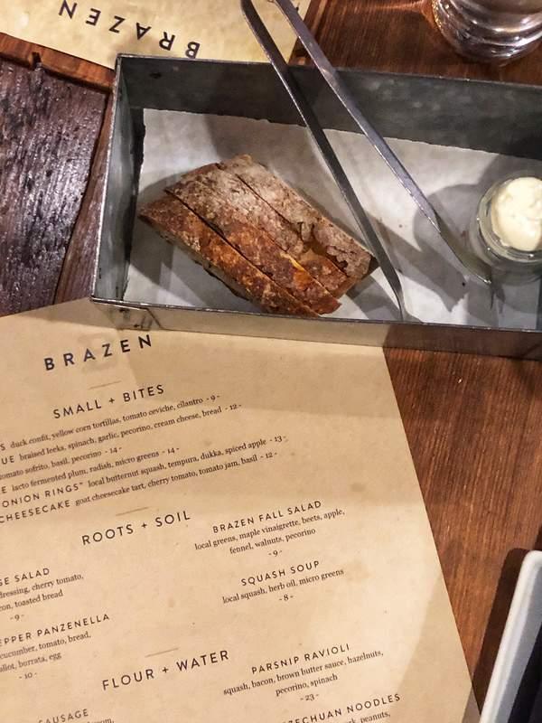 Menu and bread at Brazen, a farm-to-table restaurant in Dubuque, Iowa.