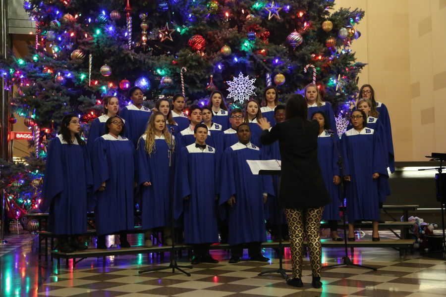 Choir singing by the Christmas tree at The Durham Museum.