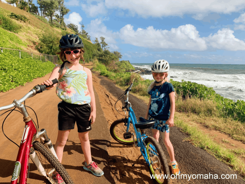 Kids posing next to their bikes on the Kapaa Bike Trail in Kauai, Hawaii