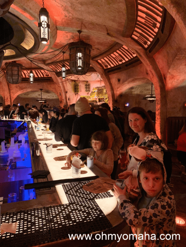 At the bar inside Oga's Cantina inside Star Wars: Galaxy's Edge in Disneyland.