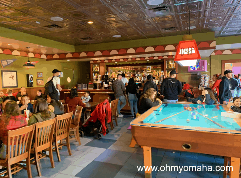 Families dining inside Moe's at Springfield™ at Universal Studios Hollywood