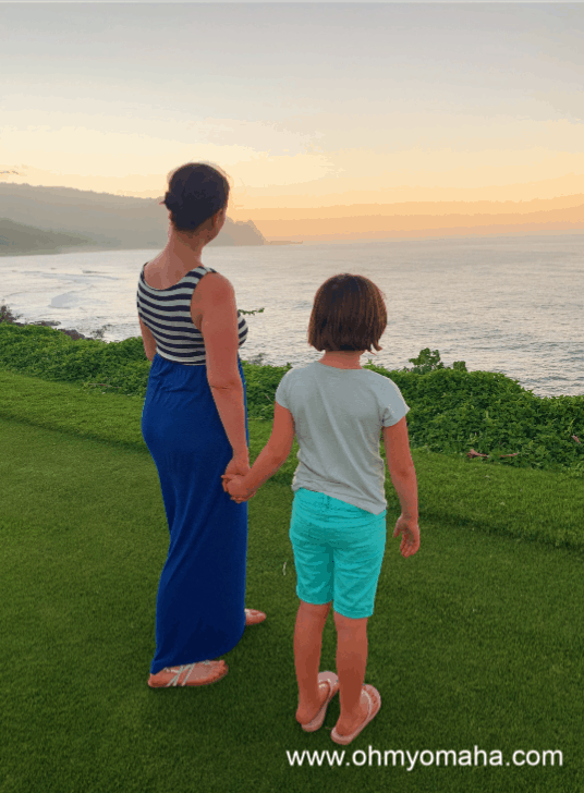 Kim and her daughter watching the remains of a Kauai sunset
