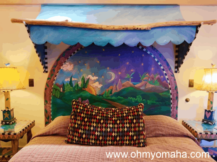 Bed in the travel-themed junior suite at Hotel Pattee