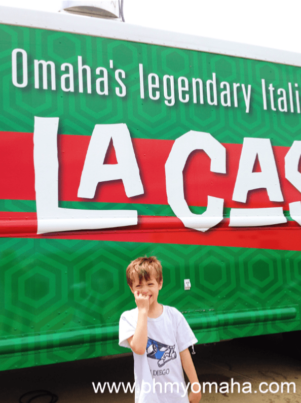 Boy in front of the La Casa food truck in Omaha