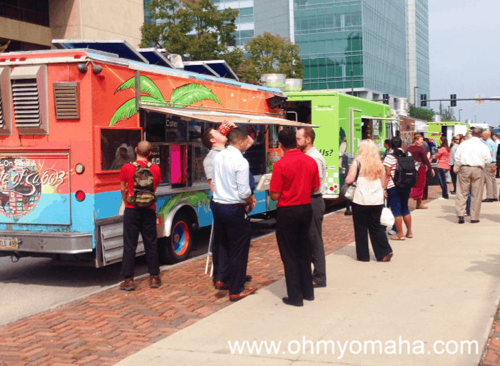 Food trucks parked on 14th Street in Downtown Omaha.