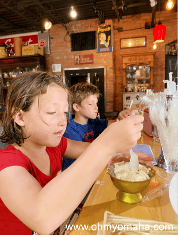 Kids having sundaes at the counter at Springfield Drug in Nebraska