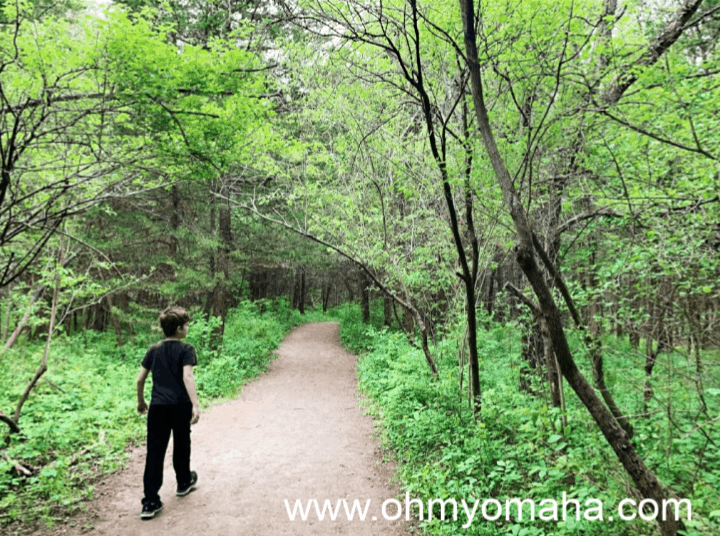 A boy on a trail at Schramm Park in Nebraska