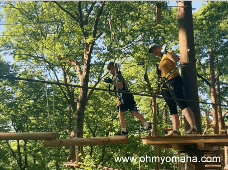 Kim and her son on the TreeRush Adventures course