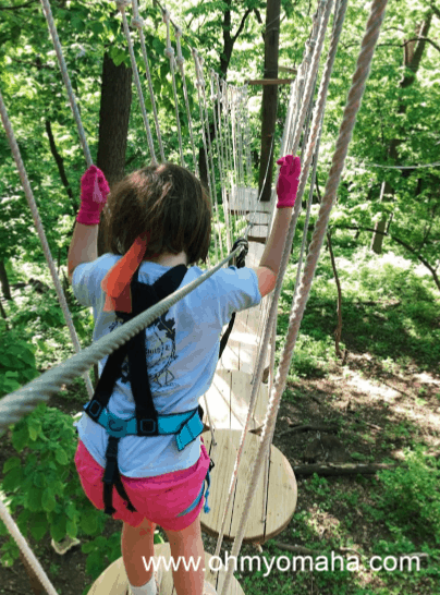 Girl on a TreeRush Adventures obstacle