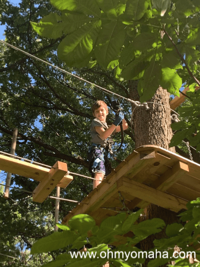Smiling boy on ropes course in Nebraska
