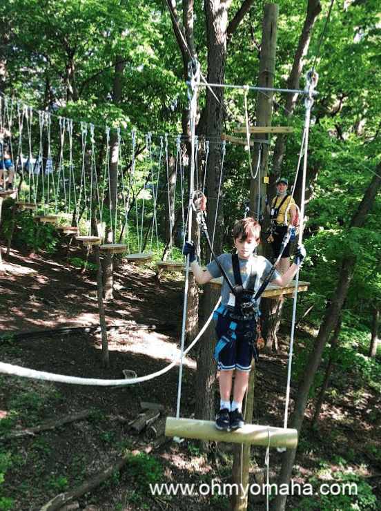 Boy on the swing obstacle at TreeRush Adventures