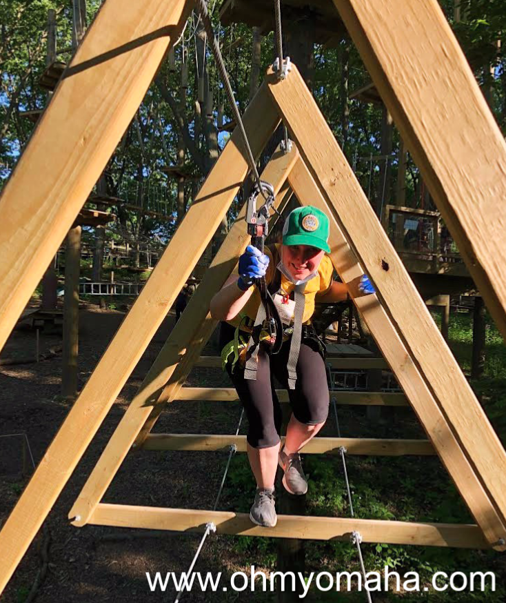 Kim going through a triangle obstacle at TreeRush Adventures