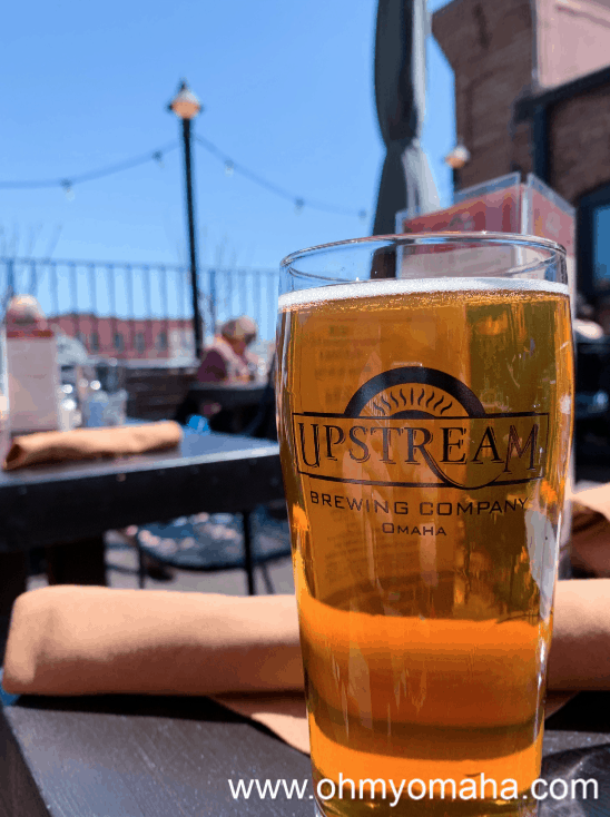 Beer on the patio of Upstream Brewing Co. in Downtown Omaha