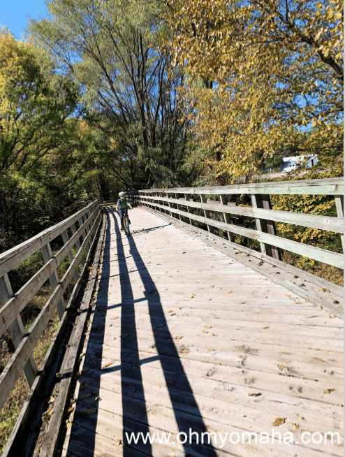 Boy biking on a bridge on the Wabash Trace Trail