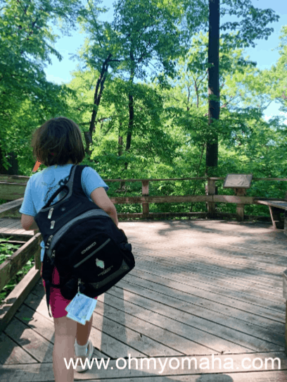 Girl with Fontenelle Forest's Family Backpack