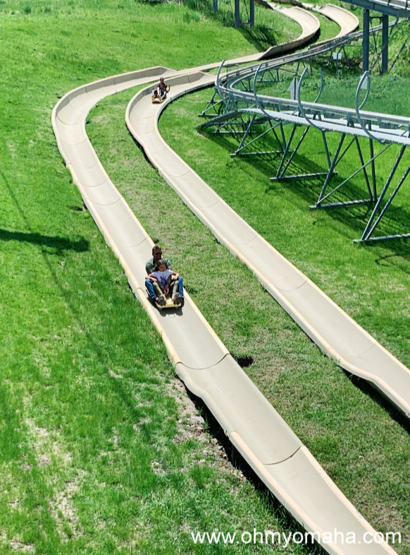 People riding the alpine slides in Jackson Hole, Wyoming.