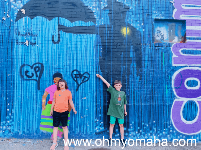 Kids in front of a mural in Art Alley, located in Rapid City, South Dakota.