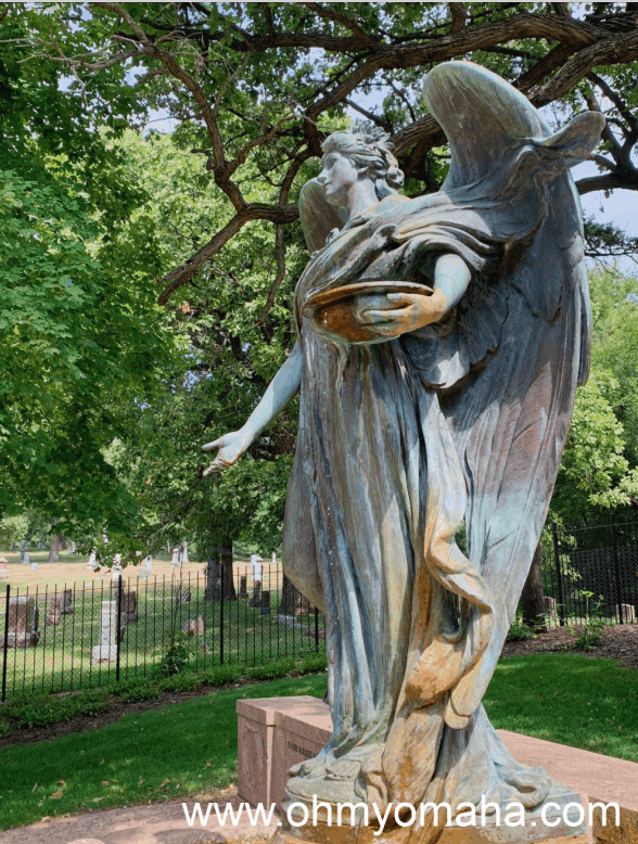 The Fairview Cemetery, located in Council Bluffs, is in the background of this Black Angel photo.