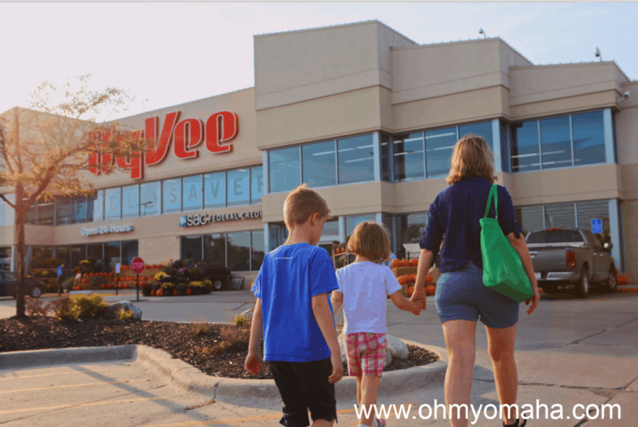 Family walking toward Hy-Vee