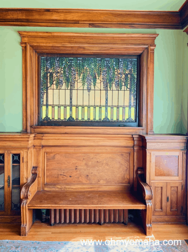 A bench and window inside Joslyn Castle in Omaha, Nebraska.