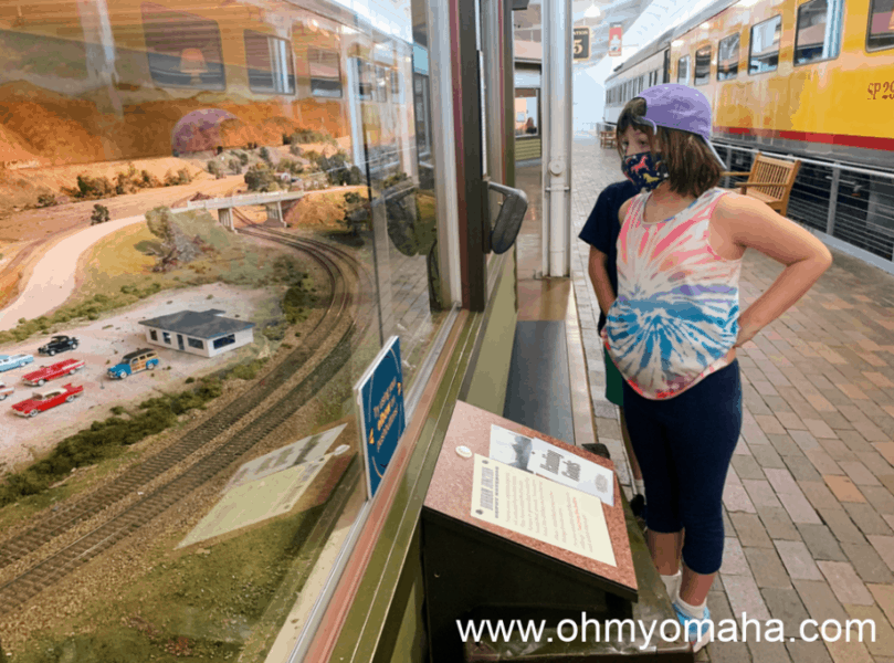 Kids watching the model trains at Durham Museum.