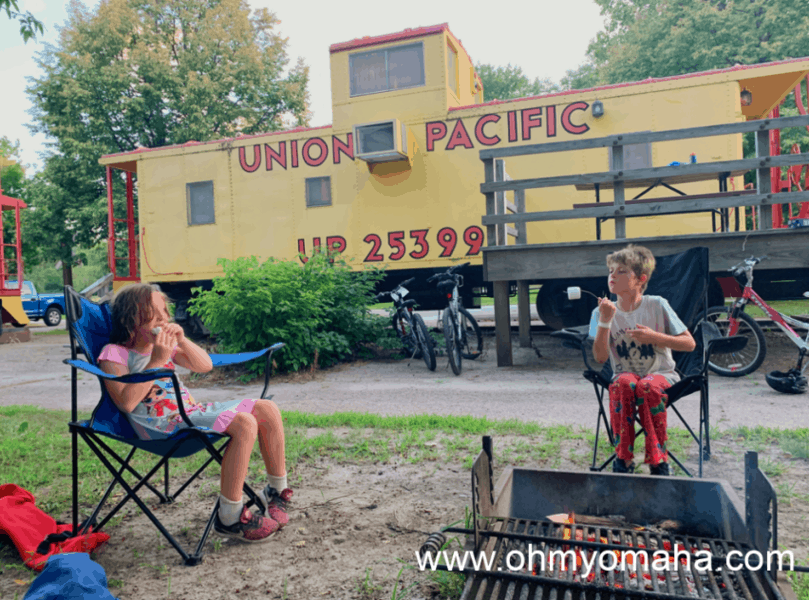 Kids in front of a caboose at Two Rivers State Recreation Area in Nebraska