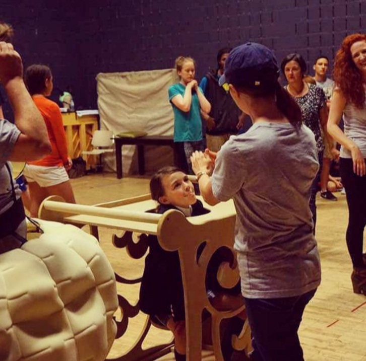 "Kimberly Faith-Hickman working with a young actor during ""Beauty & The Beast"" rehearsals."