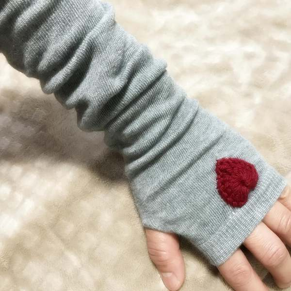 Fingerless, knit gloves made by Etsy shop Knitted Treasures
