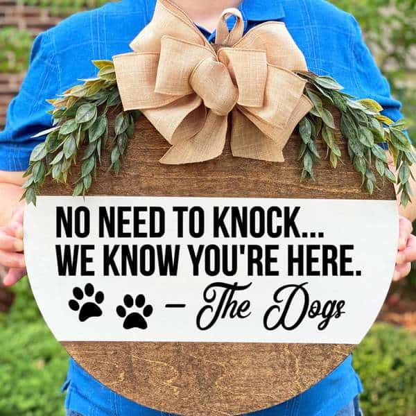 Cute door hanger available through Knotty Dogs Decor