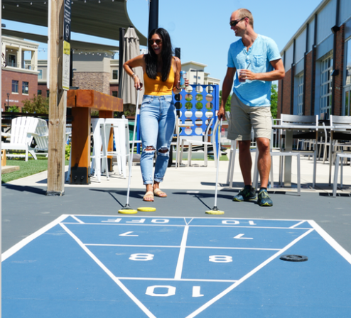 A couple plays shuffleboard at Smash Park in Des Moines, Iowa.