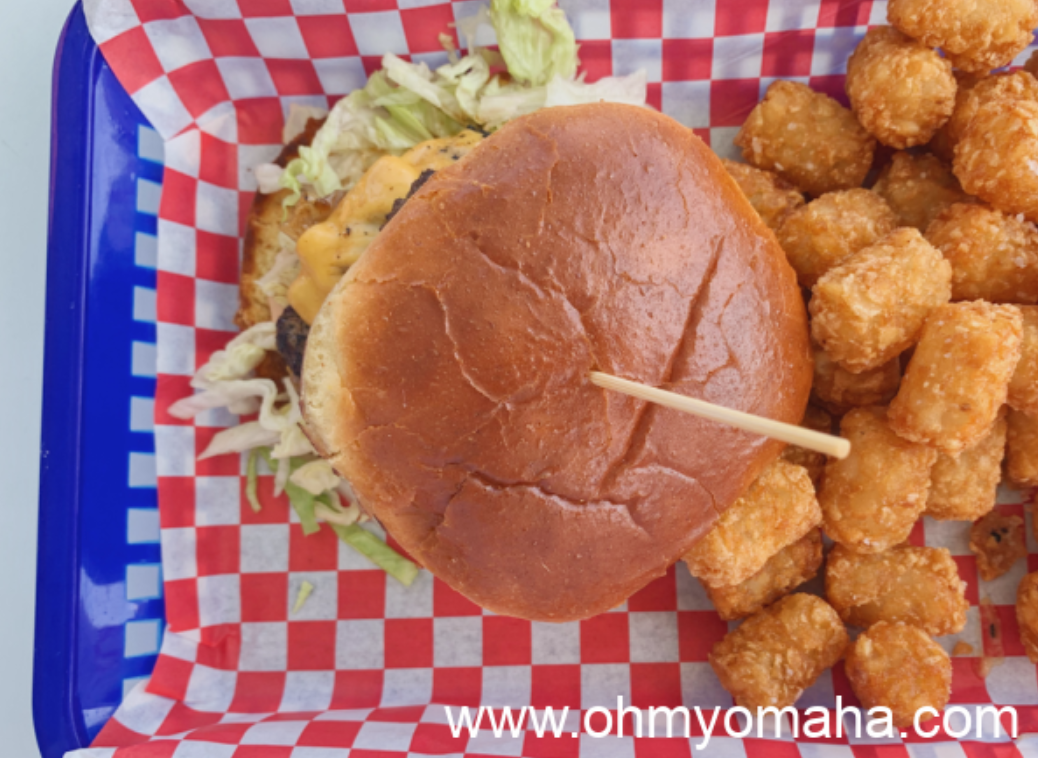 The More In Than Out Burger with a side of tots at the Anchor Bar & Grill in Orange Beach, Alabama.