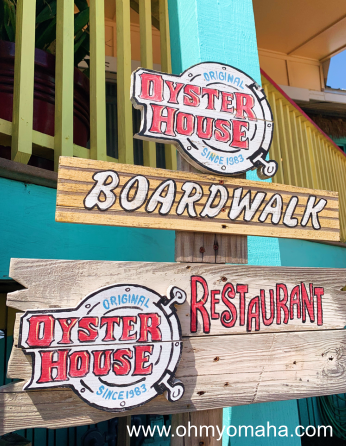 Signs in front of the Original Oyster House Restaurant.