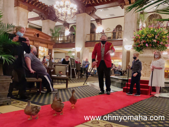 The Duck Master and honorary duck master kids walking the Peabody Hotel ducks.