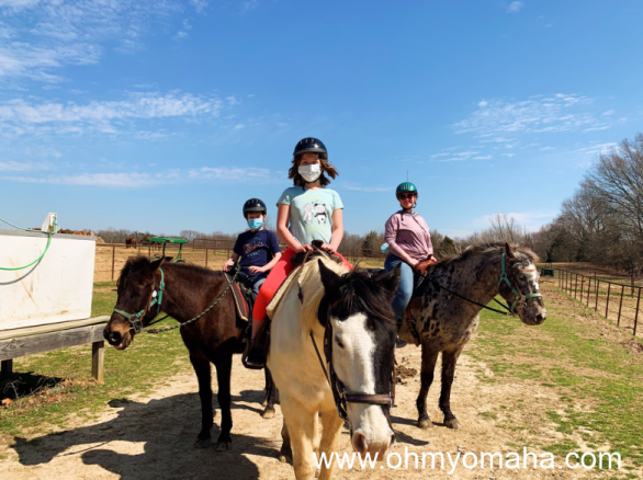My kids and I on our horses after the trail ride at Shelby Farms Park.