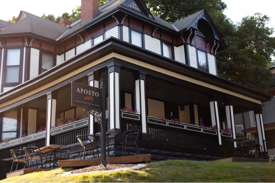 The restaurant Aposto is housed inside an 1880 Victorian mansion, and has outdoor seating on its porch.