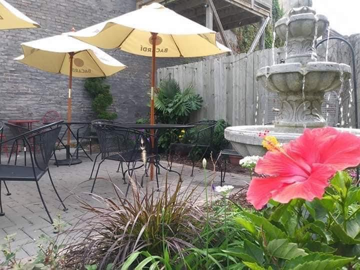 The patio at Ceviche Bar in Des Moines has a water fountain along with covered tables and chairs.
