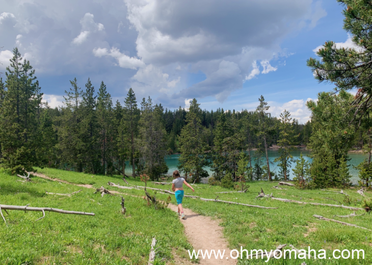 Girl running down the trail to Clear Lake in Yellowstone National Park