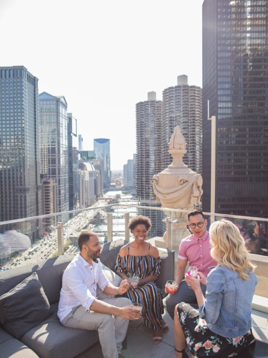 Couples having drinks on the rooftop of the London House in Chicago